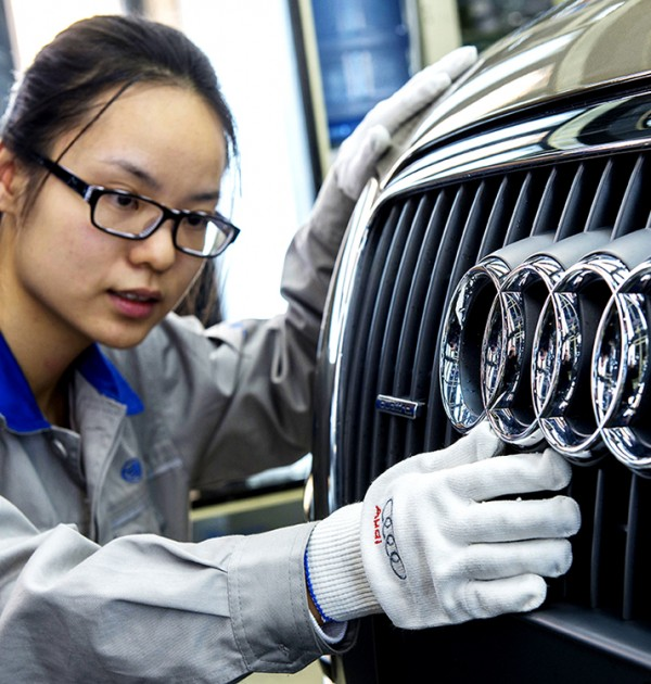 Audi apprentice with car grill and Audi rings